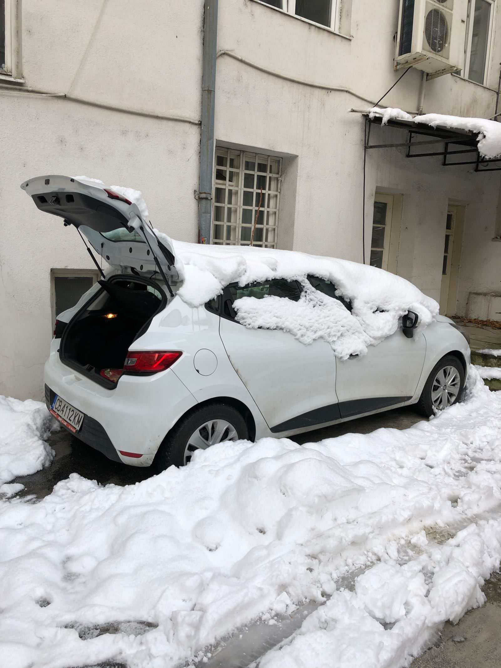 Rental Car Covered In Snow