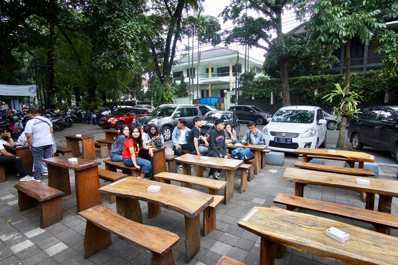 Front of Gajua Kopi Bandung with wooden tables